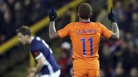 Ekspresi pemain Belanda, Memphis Depay usai membobol gawang Skotlandia pada laga persahabatan di Pittodrie, Aberdeen, Skotlandia (9/11/2017). Belanda menang 1-0. (Andrew Milligan/PA via AP)