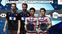 Ganda putra Indonesia, Kevin Sanjaya dan Marcus Gideon meraih gelar All England di Birmingham, Minggu (18/3/2018). Mereka juara setelah mengalahkan Mathias Boe dan Carsten Mogensen dengan skor 21-18, 21-17. (AFP/Paul Ellis)
