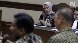Terdakwa suap mantan anggota DPR Bowo Sidik Pangarso, Asty Winasti saat sidang lanjutan di Pengadilan Tipikor Jakarta, Rabu (26/6/2019). Sidang mendengar keterangan saksi termasuk Bowo Sidik Pangarso . (Liputan6.com/Helmi Fithriansyah)