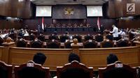 Mahkamah Konstitusi (MK) kembali menggelar sidang lanjutan perkara pengujian UU MD3 terkait hak angket KPK di Jakarta, Selasa (5/9). Sidang menghadirkan Mantan Komisioner KPK, Bambang Widjojanto sebagai saksi ahli. (Liputan6.com/Johan Tallo)