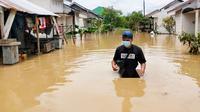 Perumahan di Pekanbaru yang terendam banjir. (Liputan6.com/M Syukur)