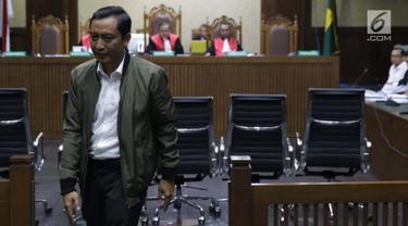 Staf khusus Menteri Agama, Gugus Joko Waskito usai memberi keterangan sebagai saksi pada sidang lanjutan dugaan suap seleksi pengisian jabatan di Kemenag dengan terdakwa Haris Hasanuddin dan M Muafad Wirahadi di Pengadilan Tipikor, Jakarta, Rabu (10/7/2019). (Liputan6.com/Helmi Fithriansyah)