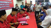 Wali Kota Palembang dan wakil kembali berduet pada Pilkada Wali Kota Palembang 2018, Sabtu (3/5/2017). (Liputan6.com/Nefri Inge)