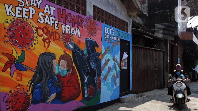 FOTO: Mural Bertema Virus Corona COVID-19 Hiasi Rumah Warga di Depok