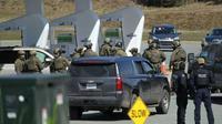 Polisi federal Kanada mengatakan tersangka ditemukan tewas setelah perburuan selama berjam-jam. (Tim Krochak / The Canadian Press via AP)