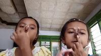 Wilda dan Nayla (dok. Instagaram @naylaqatrunnada_/https://www.instagram.com/p/BsRWcE6h5HI/Putu Elmira)