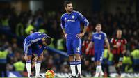 Sang juara bertahan Chelsea harus terpuruk di posisi 15 klasemen sementara Liga Inggris. Dari 17 pertandingan The Blues sudah menelan kekalahan sebanyak sembilan kali. (AFP/Justin Tallis)