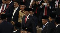 Presiden Joko Widodo atau Jokowi saat menghadiri pelantikan anggota DPR, MPR, dan DPD di Kompleks Parlemen, Jakarta, Selasa (1/10/2019). Para wakil rakyat yang terpilih dalam Pemilihan Umum 2019 dilantik hari ini. (Liputan.com/JohanTallo)