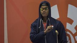 Perenang Indonesia, Jendi Pangabean, bersiap tampil pada Asian Para Games cabang renang nomor 100 meter gaya punggung S9 di Stadion Aquatic, Jakarta, Kamis (11/10). (Bola.com/Vitalis Yogi Trisna)
