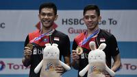 Ganda putra Indonesia, Fajar Alfian/Muhammad Rian Ardianto, menjuarai Korea Terbuka 2019 setelah mengalahkan wakil Jepang, Takeshi Kamura/Keigo Sonoda, di Incheon, Minggu (29/9). Fajar/Rian menang  21-16, 21-17. (AFP/Jung Yeon-je)