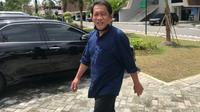Sekda Riau Yan Prana Indra Jaya usai diperiksa Kejati Riau terkait dugaan korupsi di berbagai instansi Kabupaten Siak. (Liputan6.com/M Syukur)