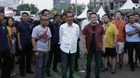 Jokowi nonton WTF 2018 (Hak Cipta: KapanLagi.com®/Agus Apriyanto/ssm)