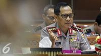 Kapolri Jenderal Tito Karnavian saat melakukan Rapat Kerja dengan Komisi III DPR di Kompleks Parlemen, Senayan, Jakarta, Rabu (31/8). Rapat tersebut membahas  revisi Undang-undang Terorisme. (Liputan6.com/Johan Tallo)