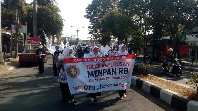Aksi demo guru honorer di Garut (LIputan6.com/Jayadi Supriadin)