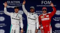 Tiga pebalap yang akan start di posisi depan, Nico Rosberg, Lewis Hamilton, dan Kimi Raikkonen dalam balapan F1 GP Brasil di Sirkuit Interlagos, Minggu (13/11/2016). (AFP/Miguel Schincariol)
