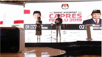Moderator debat keempat Pilpres 2019 Retno Pinasti dan Zulfikar Naghi.
