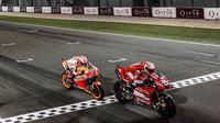 Andrea Dovizioso finis di posisi pertama pada MotoGP Qatar, hanya unggul 0,020 detik dari Marc Marquez. (Twitter/MotoGP)