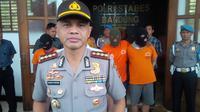 Pengeroyok sopir ojek online di Bandung itu merupakan tersangka yang sempat buron sepekan ke luar kota. Ia pulang karena kangen. (Liputan6.com/Aditya Prakasa)