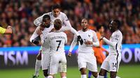 Para pemain Prancis saat merayakan gol Paul Pogba ke gawang Belanda pada pertandingan lanjutan Kualifikasi Piala Dunia 2018, di Amsterdam Arena, Senin atau Selasa (11/10/2016) dini hari WIB. (AFP/Emmanuel Dunand).