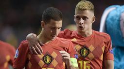 Keakraban kakak adik Eden Hazard (kiri) dengan Thorgan Hazard. Meski terpisah di level klub, keduanya bermain bersama di Timnas Belgia. (Foto: AFP/Belga/Yorick Jansens)