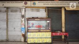 Suasana Terminal Bus Kampung Rambutan yang sepi aktivitas di Jakarta, Minggu (10/5/2020). Pelayanan Bus AKAP belum dioperasionalkan di Terminal Kampung Rambutan, meskipun pemerintah telah mengizinkan kembali angkutan umum beroperasi keluar masuk wilayah Jabodetabek. (Liputan6.com/Immanuel Antonius)