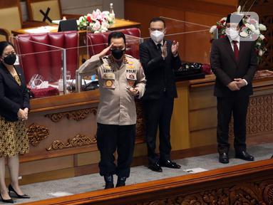 Calon Kapolri Komjen Pol Listyo Sigit Prabowo (tengah) foto bersama pimpinan DPR usai Sidang Paripurna di Kompleks Parlemen, Jakarta, Kamis (21/1/2020). DPR menyepakati penetapan Listyo sebagai Kapolri setelah melalui uji kepatutan dan kelayakan Komisi III DPR. (Liputan6.com/Angga Yuniar)