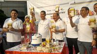 Perum Bulog meluncurkan produk terbaru, yakni beras dengan penambahan zat gizi mikro atau beras fortifikasi kualitas premium seharga Rp 20 ribu per kg. (Liputan6.com/Maulandy Rizky Bayu Kencana)
