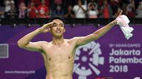 Selebrasi pebulu tangkis Indonesia, Jonatan Christie usai mengalahkan Chou Tienchen asal Chinese Taipei laga pada final tunggal putra Asian Games 2018 di Jakarta, Selasa (28/8). (ANTARA FOTO/INASGOC/Puspa Perwitasari/tom/18)