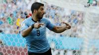 Penyerang Uruguay, Luis Suarez merayakan gol ke gawang Arab Saudi pada pertandingan kedua Grup A di Rostov Arena, Rostov-on-Don, Rabu (20/6). Gol tunggal Suarez memastikan Uruguay lolos ke babak 16 besar Piala Dunia 2018. (AP/Andrew Medichini)