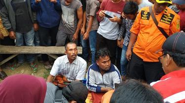 Evakuasi bocah lima tahun yang diterkam buaya di Sungai Indragiri, Provinsi Riau.