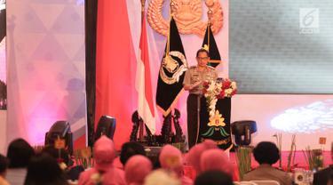 Kapolri Jendral Tito Karnavian memberikan sambutan saat menghadiri hari jadi Polisi Wanita (Polwan) yang ke-69 di ruang aula Perguruan Tinggi Ilmu Kepolisian (PTIK), Jakarta, Senin (11/9). (Liputan6.com/Faizal Fanani)