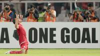 Gaya pemain Persija Jakarta Addison Oliveira merayakan gol ke gawang Song Lam Nghe An pada laga Piala AFC 2018 di Stadion Utama GBK, Senayan, Jakarta, (13/3/2018). Persija Jakarta menang 1-0. (Bola.com/Nick Hanoatubun)