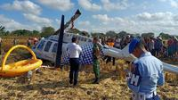 Insiden jatuhnya helikopter yang dioperasikan oleh PT Carpediem Air di Desa Kawo, Pujut, Lombok Tengah, Minggu (14/7/2019). (Dok Kemenhub)