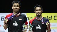 Ganda putra Indonesia, Mohammad Ahsan/Hendra Setiawan, meraih gelar pada Kejuaraan Dunia Bulutangkis 2019. (PBSI)