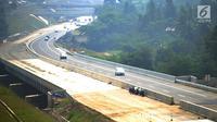 Kondisi arus lalu lintas di jalan fungsional Bocimi di kawasan Cigombong, Bogor (9/6). Ruas Tol Bocimi Seksi I akan terus dibuka secara fungsional tanpa tarif alias gratis hingga H+7 Lebaran. (Merdeka.com/Arie Basuki)