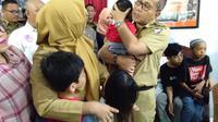 Tiga bocah korban penyekapan ibu asuhnya kini merasa riang dan gembira (Liputan6.com/ Eka hakim)