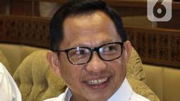 Menteri Dalam Negeri Tito Karnavian saat Rapat Kerja dengan Komisi II DPR di Kompleks Parlemen, Senayan, Jakarta, Selasa (26/2/2020). Rapat tersebut membahas berbagai isu, di antaranya Pilkada 2020 dan pengamanan kontingen PON selama berada di Papua. (Liputan6.com/Johan Tallo)
