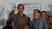 Presiden terpilih Joko Widodo dan Jusuf Kalla adakan jumpa pers di Rumah Transisi, Jakarta (15/9/2014) (Liputan6.com/Herman Zakharia)