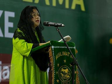 Menko PMK Puan Maharani memberi pidato saat acara pelantikan pengurus pimpinan pusat Muslimat Nahdlatul Ulama dan peringatan Harlah Muslimat NU yang Ke 71 di Masjid Istiqlal, Jakarta, Selasa (28/3). (Liputan6.com/Faizal Fanani)