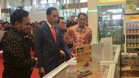 Presiden Joko Widodo (Jokowi) meninjau pameran dan forum Indo Livestock 2018 di Jakarta Convention Centar (JCC), Senayan, Jumat (6/7/2018).