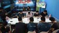 Suasana sesi Main Bareng (MaBar) Tim EVOS dengan pengunjung JFK 2019 di Area Gaming 'Good Luck Have Fun' (GLHF Corner).  (FOTO / Ist)