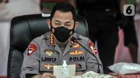 Kapolri Jenderal Listyo Sigit Prabowo menyampaikan keterangan saat rilis kasus narkoba jaringan Timur Tengah di Mapolda Metro Jaya, Jakarta, Senin (14/6/2021). Ratusan paket sabu dikemas dengan tiga jenis paket yang berbeda. (merdeka.com/Iqbal S. Nugroho)