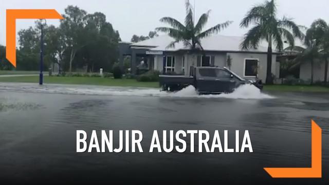 Ribuan warga Queensland, Australia terpaksa mengungsi karena permukiman mereka terenda banjir akibat derasnya curah hujan.