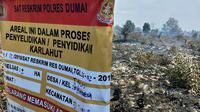 Tanda segel kebakaran lahan yang dibuat polisi untuk diselidiki karena menyebabkan kabut asap di Riau. (Liputan6.com/ M Syukur)