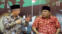 Anggota Komisi XI F-PDIP Hendrawan Supratikno (kiri) bersama Waketum Partai Gerindra Arief Poyuono saat diskusi di Jakarta, Kamis (11/10). Diskusi mempertanyakan anggaran Rp 810 M penyelenggaraan IMF-World Bank 2018. (Liputan6.com/JohanTallo)