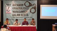 Diskusi tentang ancaman kriminalisasi narasumber dalam berita. (Merdeka.com)