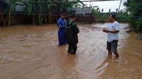 Tanggul Sungai Tanjungrejo di Kecamatan Margoyoso, Kabupaten Pati, jebol. (Liputan6.com/Ahmad Adirin)