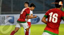 Achamad Jufriyanto mengepalkan tangan usai mencetak gol ke gawang Kyrgyzstan (Liputan6.com/ Helmi Fithriansyah)