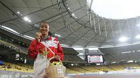 Pelari Indonesia, Putri Aulia, sukses menyumbang tiga medali emas pada debutnya di ASEAN Para Games 2017. (dok. APG Indonesia)