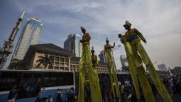 Suasana kemeriahan saat Parade Asian Games 2018 di Jakarta, Minggu (13/5/2018). Parade ini diadakan untuk mempopulerkan multievent empat tahunan tersebut. (Bola.com/Vitalis Yogi Trisna)